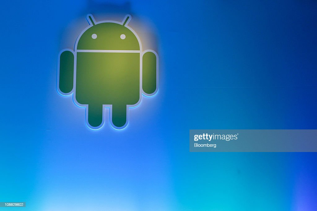 Google Inc.'s Android logo is displayed during a news conference at company headquarters in Mountain View, California, U.S., on Wednesday, Feb. 2, 2011. Google Inc., owner of the world's most popular Internet search engine, opened a Web browser-based market for users of its Android smartphone software to buy applications as it battles Apple Inc. for market share. Photographer: Tony Avelar/Bloomberg via Getty Images