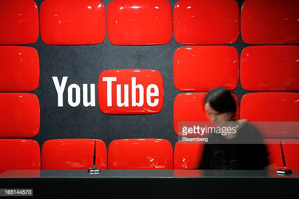 Google Inc's YouTube logo is displayed behind the reception desk at the company's YouTube Space studio in Tokyo Japan on Saturday March 30 2013 In...