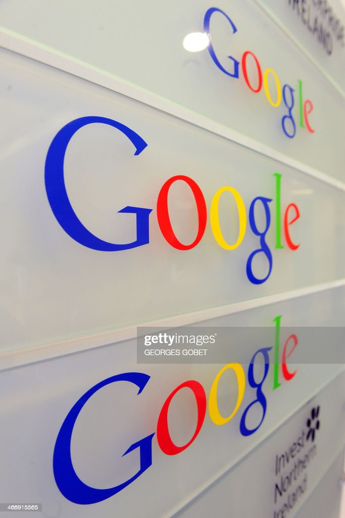 Google logo is seen on a wall at the entrance of the Google offices in Brussels on February 5, 2014. The European Commission accepted the latest proposals by US giant Google to remedy complaints it abuses its dominant position in the Internet search market, opening the way to a settlement.'I believe that the new proposal obtained from Google after long and difficult talks can now address the Commission's concerns,' Almunia said
