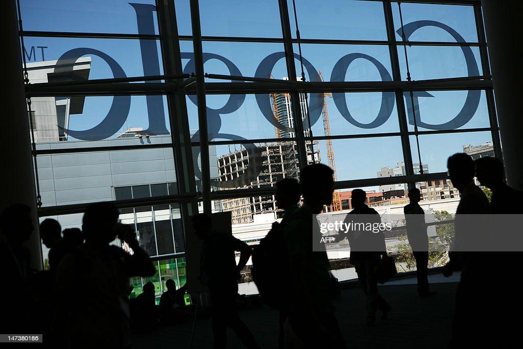 A Google logo is seen through windows of Moscone Center in San Francisco during Google's annual developer conference, Google I/O, in San Francisco on June 28, 2012 in California. AFP PHOTO / Kimihiro Hoshino