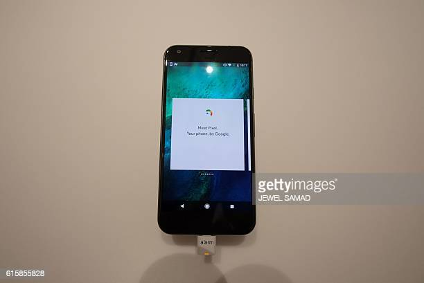 A Google pixel phone is seen on display after the opening of Google's popup store in New York on October 20 2016 Google opened its first retail store...