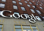 A Google sign hangs on their headquarters May 21 2014 in New York City