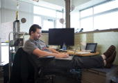 Google software engineer Greg Millam works at his desk at Google Kirkland October 28 2009 in Kirkland Washington More than 350 employees work in the...