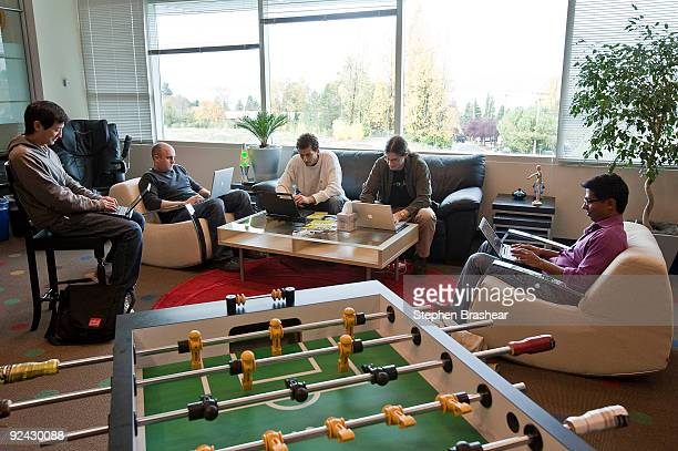 Google Software Engineers from left Keith Ito Nicholas Lee John Leen and Yatin Chawathe work in a room with a view and a foosball table at the newly...