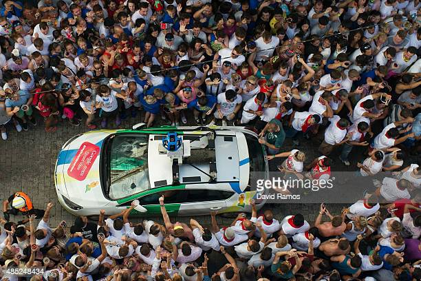 Google Street View car drives through revellers during the annual Tomatina festival on August 26 2015 in Bunol Spain An estimated 22000 people threw...