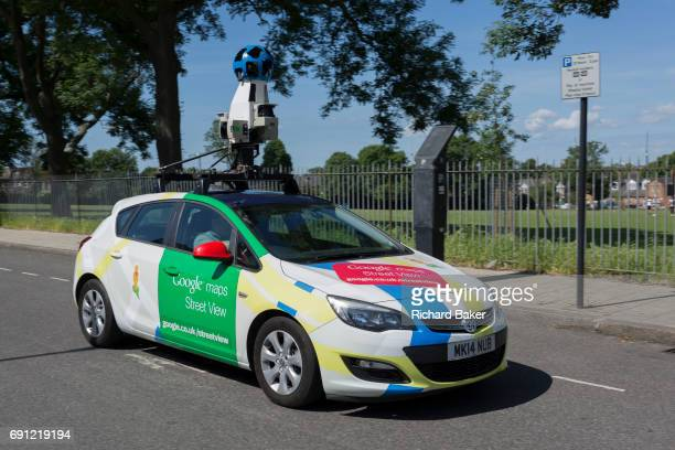 A Google Street View mapping car drives alongside a public park in the borough of Lambethon 1st June 2017 in south London England