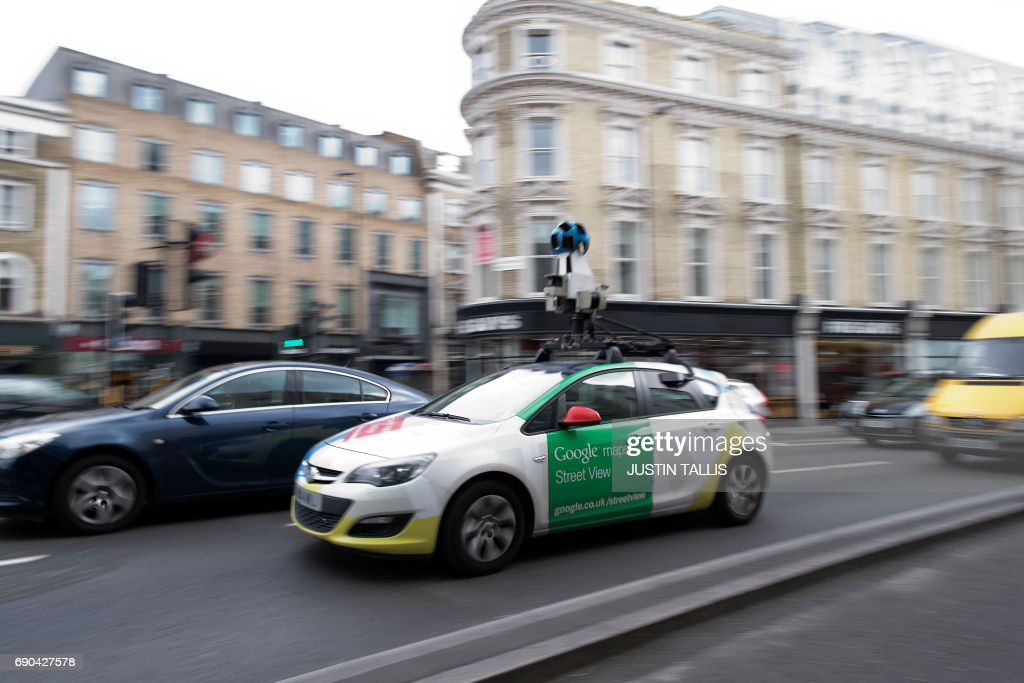 A Google Street View vehicle is pictured on a road in central London on May 31, 2017. / AFP PHOTO / Justin TALLIS