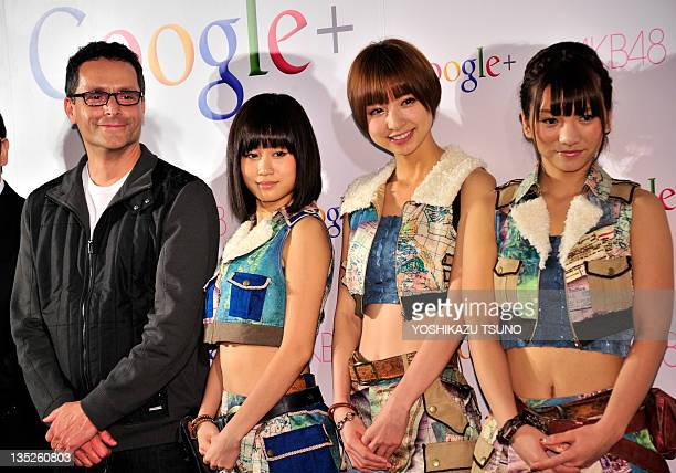 Google vice president Bradley Horowitz smiles with Japanese allgirl pop group AKB48 members Atsuko Maeda Mariko Shinoda and Aki Takajo as they...