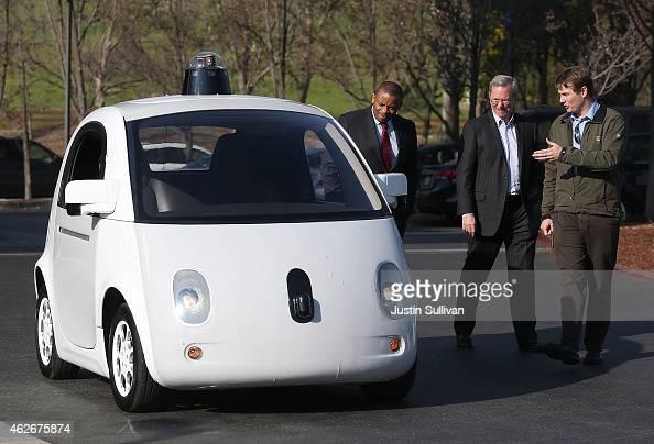 Google's Chris Urmson shows a Google selfdriving car to US Transportation Secretary Anthony Foxx and Google Chairman Eric Schmidt at the Google...
