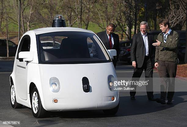 Google's Chris Urmson shows a Google selfdriving car to US Transportation Secretary Anthony Foxx and Google Chairman Eric Schmidt at the Google...