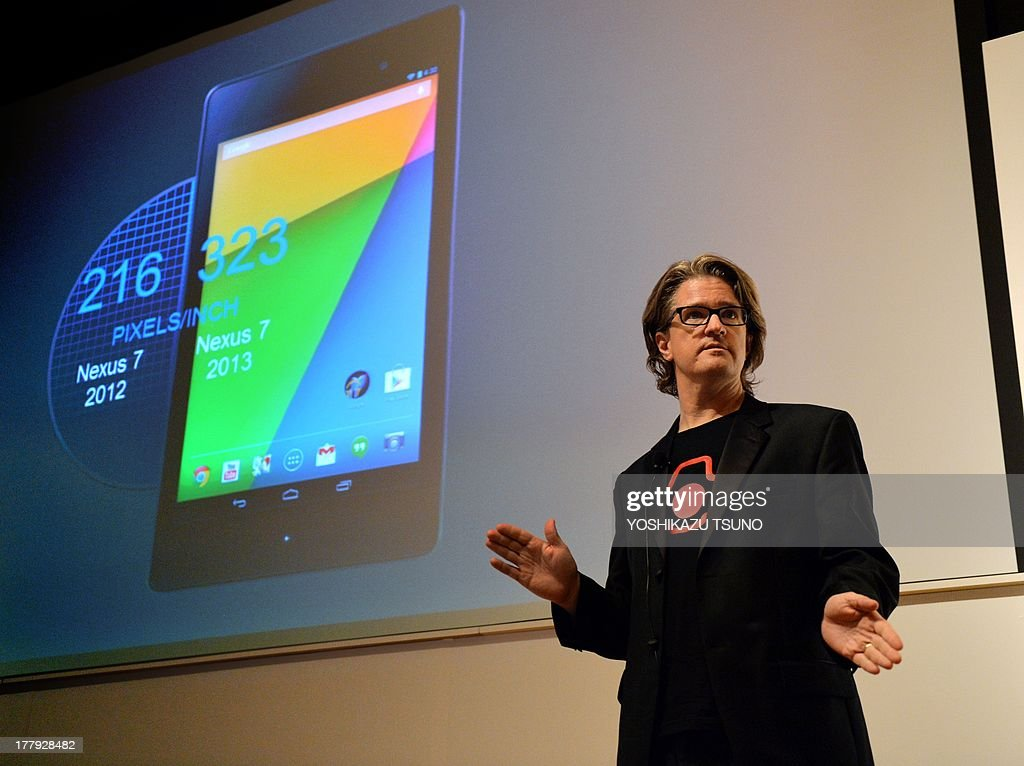 Google's engineering director Chris Yerga speaks next to an image of the new 'Nexus 7' tablet produced by Taiwan's computer maker Asus in Tokyo on August 26, 2013. The Nexus 7 will go on sale in Japan on August 28. AFP PHOTO / Yoshikazu TSUNO