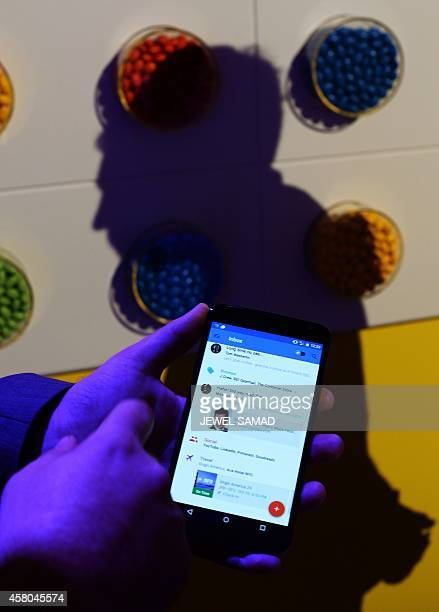 Google's lead designer for 'Inbox by Gmail' Jason Cornwell shows the app's functionalities on a nexus 6 android phone during a media preview in New...