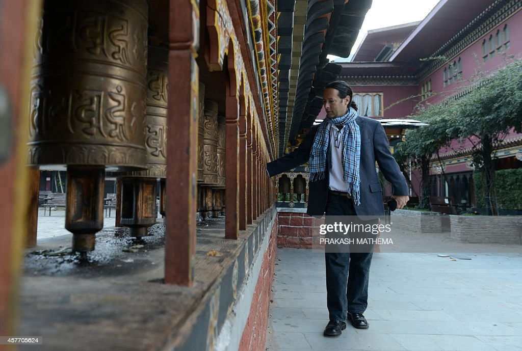 Google's Street View Manager Divon Lan spins prayer wheels in Thimphu on October 23 2014 Google provided a sneak peek into Bhutan October 23 by...