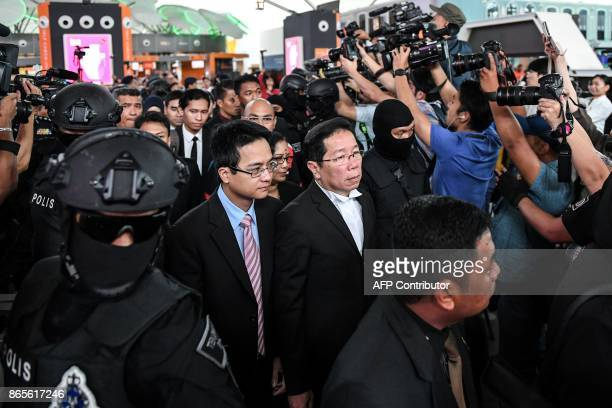 TOPSHOT Gooi Soon Seng lawyer for Indonesian defendant Siti Aisyah is escorted by police personnel at the lowcost carrier Kuala Lumpur International...