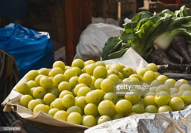 Gooseberries and vegetables at a market stall, Delhi, India