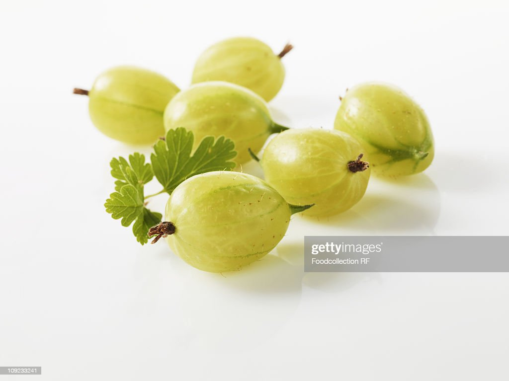 Gooseberries on white background, close-up : Stock Photo