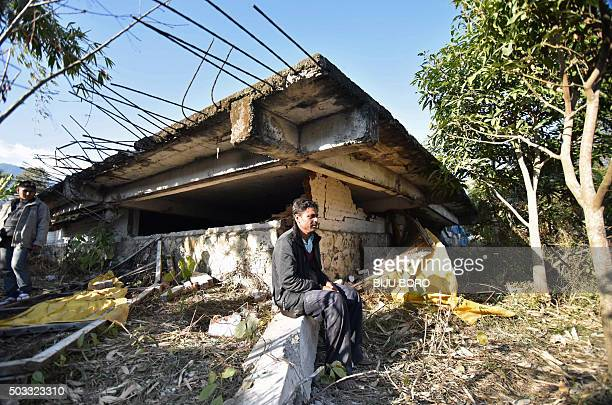 Gopal Motea sits in front of his collapsed house where his mother and daughter were killed in a 67 magnitude earthquake in Leimakhong village on the...