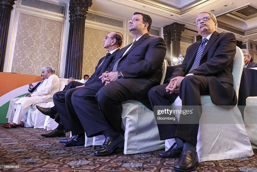 S. Gopalakrishnan, vice chairman of Infosys Ltd., from right, <a gi-track='captionPersonalityLinkClicked' href=/galleries/search?phrase=Cyrus+Mistry&family=editorial&specificpeople=8705051 ng-click='$event.stopPropagation()'>Cyrus Mistry</a>, chairman of Tata Group, and billionaire Adi Godrej, chairman of the Godrej Group, attend the launch of India@75: Call To Action in Mumbai, India, on Thursday, Nov. 14, 2013. Infosys is Indias second-largest software exporter. Photographer: Dhiraj Singh/Bloomberg via Getty Images