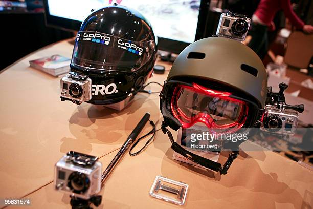 GoPro wearable digital camera rigs sit on display during the Digital Experience event at the 2010 International Consumer Electronics Show in Las...