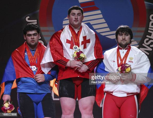 Gor Mynasian of Armenia Lasha Talakhazde of Georgia and Darius Jokarzadeh og Great Britain in the podium of Men's 105kg A during day seven of the...