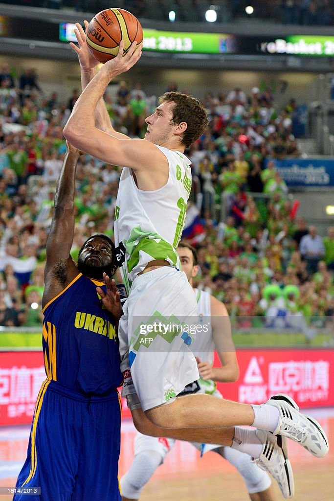 Goran Dragic (R) of Slovenia vies with Eugene Jeter of Ukraine during a EuroBasket championship basketball match for the 5th place between Slovenia and Ukraine in Ljubljana, Slovenia, on September 21, 2013.