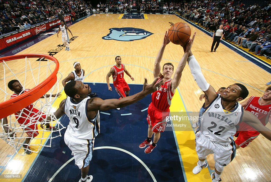 <a gi-track='captionPersonalityLinkClicked' href=/galleries/search?phrase=Goran+Dragic&family=editorial&specificpeople=4452965 ng-click='$event.stopPropagation()'>Goran Dragic</a> #3 of the Houston Rockets battles for the rebound against <a gi-track='captionPersonalityLinkClicked' href=/galleries/search?phrase=Tony+Allen+-+Basketball+Player&family=editorial&specificpeople=201665 ng-click='$event.stopPropagation()'>Tony Allen</a> #9 and <a gi-track='captionPersonalityLinkClicked' href=/galleries/search?phrase=Rudy+Gay&family=editorial&specificpeople=236066 ng-click='$event.stopPropagation()'>Rudy Gay</a> #22 of the Memphis Grizzlies on February 14, 2012 at FedExForum in Memphis, Tennessee.