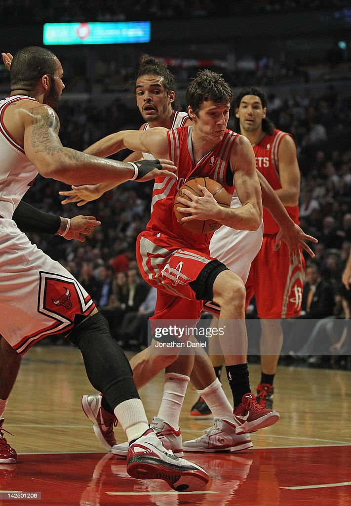 Goran Dragic #3 of the Houston Rockets drives between Carlos Boozer #5 and Joakim Noah #13 of the Chicago Bulls at the United Center on April 2, 2012 in Chicago, Illinois. The Rockets defeated the Bulls 99-93.