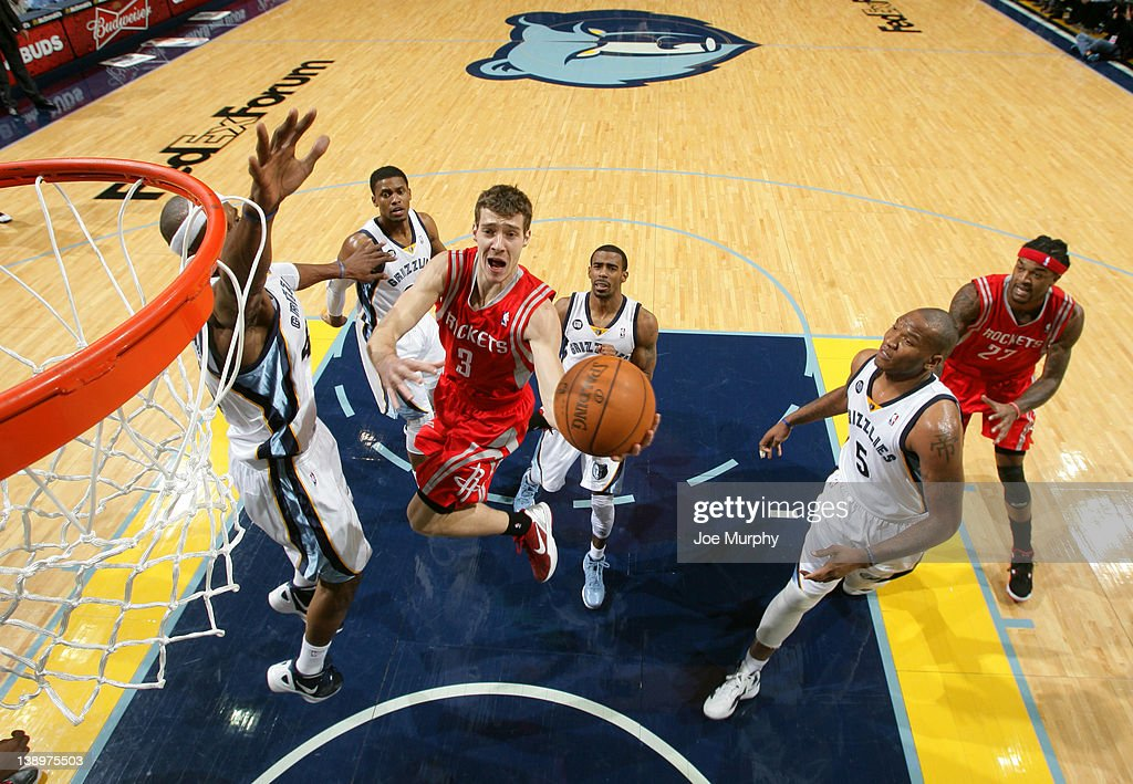<a gi-track='captionPersonalityLinkClicked' href=/galleries/search?phrase=Goran+Dragic&family=editorial&specificpeople=4452965 ng-click='$event.stopPropagation()'>Goran Dragic</a> #3 of the Houston Rockets goes to the basket against <a gi-track='captionPersonalityLinkClicked' href=/galleries/search?phrase=Dante+Cunningham&family=editorial&specificpeople=683729 ng-click='$event.stopPropagation()'>Dante Cunningham</a> #44 of the Memphis Grizzlies on February 14, 2012 at FedExForum in Memphis, Tennessee.