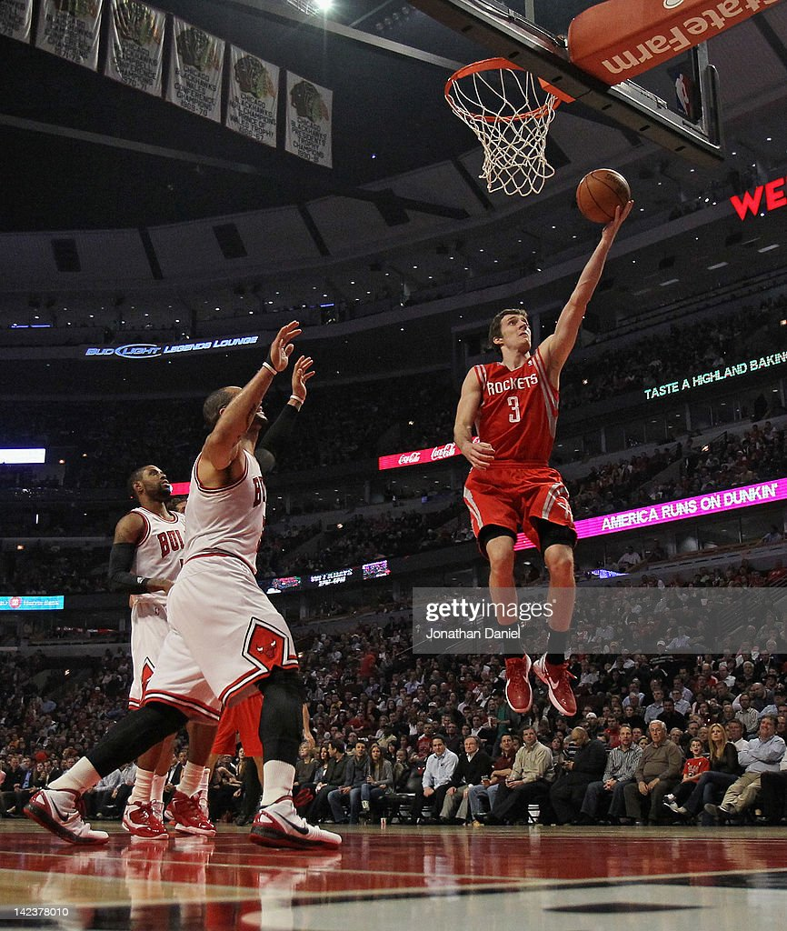 Goran Dragic #3 of the Houston Rockets goes up for a shot past Carlos Boozer #5 of the Chicago Bulls at the United Center on April 2, 2012 in Chicago, Illinois. The Rockets defeated the Bulls 99-93.