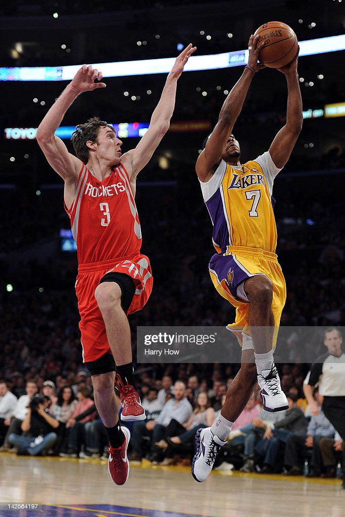 <a gi-track='captionPersonalityLinkClicked' href=/galleries/search?phrase=Goran+Dragic&family=editorial&specificpeople=4452965 ng-click='$event.stopPropagation()'>Goran Dragic</a> #3 of the Houston Rockets jumps with <a gi-track='captionPersonalityLinkClicked' href=/galleries/search?phrase=Ramon+Sessions&family=editorial&specificpeople=805440 ng-click='$event.stopPropagation()'>Ramon Sessions</a> #7 of the Los Angeles Lakers to prevent his shot at Staples Center on April 6, 2012 in Los Angeles, California.