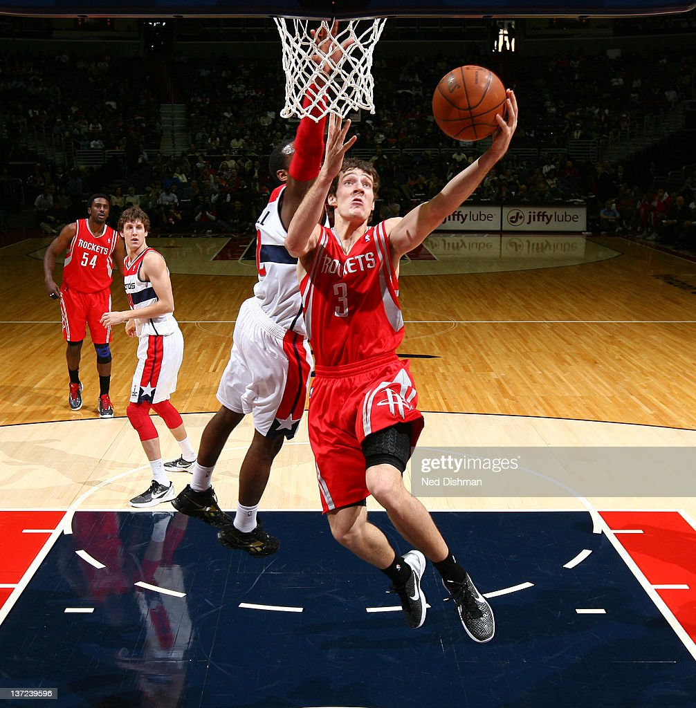 <a gi-track='captionPersonalityLinkClicked' href=/galleries/search?phrase=Goran+Dragic&family=editorial&specificpeople=4452965 ng-click='$event.stopPropagation()'>Goran Dragic</a> #3 of the Houston Rockets shoots against John Wall #2 of the Washington Wizards during the game at the Verizon Center on January 16, 2012 in Washington, DC.