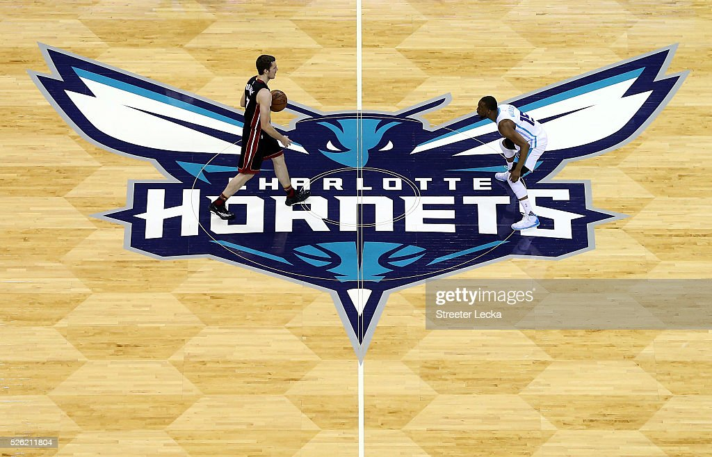 Goran Dragic of the Miami Heat brings the ball up the court against Kemba Walker of the Charlotte Hornets during game six of the Eastern Conference...
