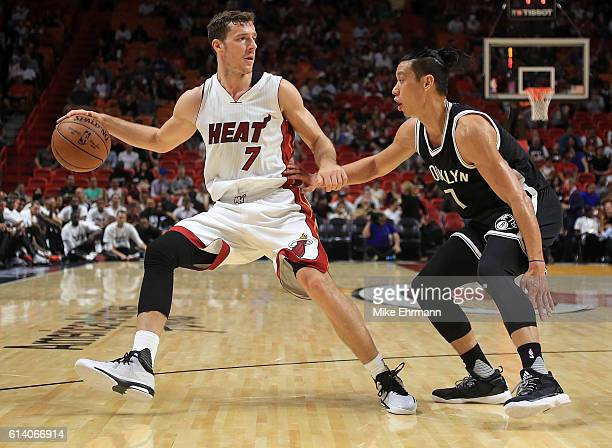 Goran Dragic of the Miami Heat drives on Jeremy Lin of the Brooklyn Nets during a preseason game at American Airlines Arena on October 11 2016 in...