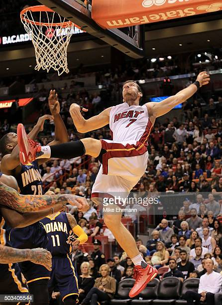 Goran Dragic of the Miami Heat drivs to the basket during a game against the Indiana Pacers at American Airlines Arena on January 4 2016 in Miami...