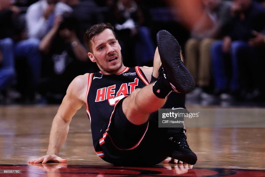 Goran Dragic #7 of the Miami Heat falls to the court in the third quarter against the Portland Trail Blazers at American Airlines Arena on December 13, 2017 in Miami, Florida.