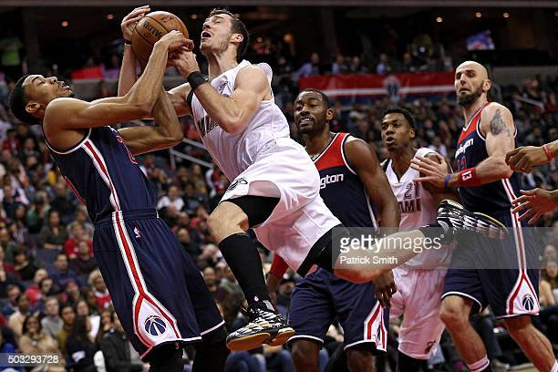 Goran Dragic of the Miami Heat has his shot blocked by Otto Porter Jr #22 of the Washington Wizards during the first half at Verizon Center on...