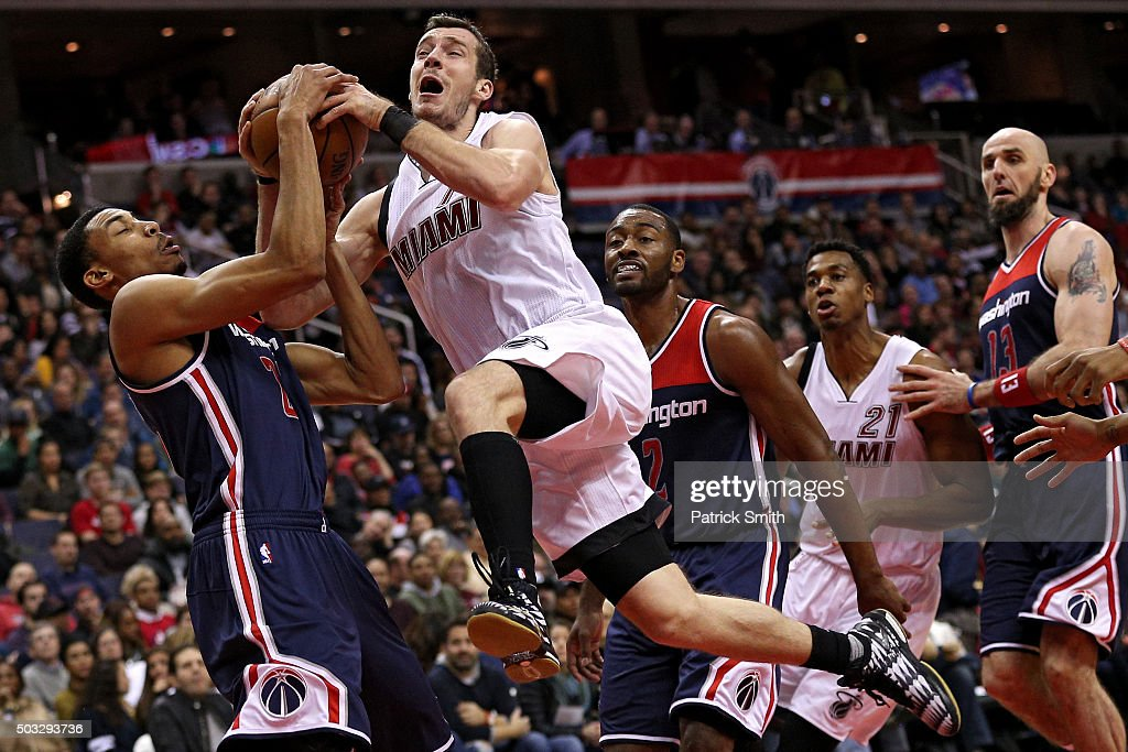 Goran Dragic #7 of the Miami Heat has his shot blocked by Otto Porter Jr. #22 of the Washington Wizards during the first half at Verizon Center on January 3, 2016 in Washington, DC.