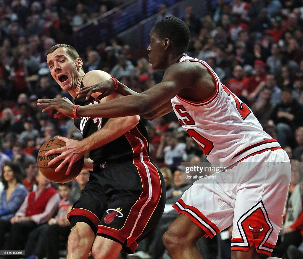 <a gi-track='captionPersonalityLinkClicked' href=/galleries/search?phrase=Goran+Dragic&family=editorial&specificpeople=4452965 ng-click='$event.stopPropagation()'>Goran Dragic</a> #7 of the Miami Heat is fouled by <a gi-track='captionPersonalityLinkClicked' href=/galleries/search?phrase=Tony+Snell&family=editorial&specificpeople=7551553 ng-click='$event.stopPropagation()'>Tony Snell</a> #20 of the Chicago Bulls at the United Center on March 11, 2016 in Chicago, Illinois.