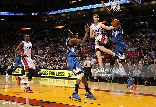 Goran Dragic of the Miami Heat passes over Andrew Wiggins of the Minnesota Timberwolves during a game at American Airlines Arena on November 17 2015...