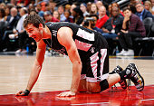 Goran Dragic of the Miami Heat reacts after having part of one of his front teeth knocked out while defending Al Horford of the Atlanta Hawks at...