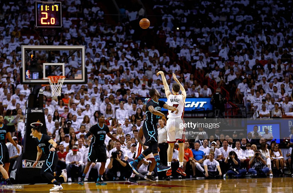 <a gi-track='captionPersonalityLinkClicked' href=/galleries/search?phrase=Goran+Dragic&family=editorial&specificpeople=4452965 ng-click='$event.stopPropagation()'>Goran Dragic</a> #7 of the Miami Heat shoots over <a gi-track='captionPersonalityLinkClicked' href=/galleries/search?phrase=Kemba+Walker&family=editorial&specificpeople=5042442 ng-click='$event.stopPropagation()'>Kemba Walker</a> #15 of the Charlotte Hornets during Game Seven of the Eastern Conference Quarterfinals of the 2016 NBA Playoffs at American Airlines Arena on May 1, 2016 in Miami, Florida.