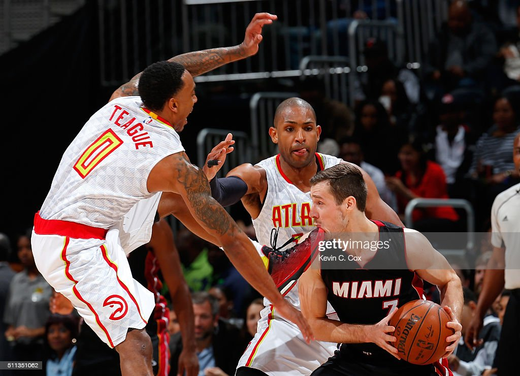 <a gi-track='captionPersonalityLinkClicked' href=/galleries/search?phrase=Goran+Dragic&family=editorial&specificpeople=4452965 ng-click='$event.stopPropagation()'>Goran Dragic</a> #7 of the Miami Heat takes a foot to the chin as he is defended by <a gi-track='captionPersonalityLinkClicked' href=/galleries/search?phrase=Jeff+Teague&family=editorial&specificpeople=4680498 ng-click='$event.stopPropagation()'>Jeff Teague</a> #0 and <a gi-track='captionPersonalityLinkClicked' href=/galleries/search?phrase=Al+Horford&family=editorial&specificpeople=699030 ng-click='$event.stopPropagation()'>Al Horford</a> #15 of the Atlanta Hawks at Philips Arena on February 19, 2016 in Atlanta, Georgia. NOTE TO USER User expressly acknowledges and agrees that, by downloading and or using this photograph, user is consenting to the terms and conditions of the Getty Images License Agreement.