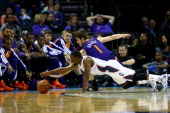 Goran Dragic of the Phoenix Suns and Kemba Walker of the Charlotte Bobcats dive after a loose ball during their game at Time Warner Cable Arena on...