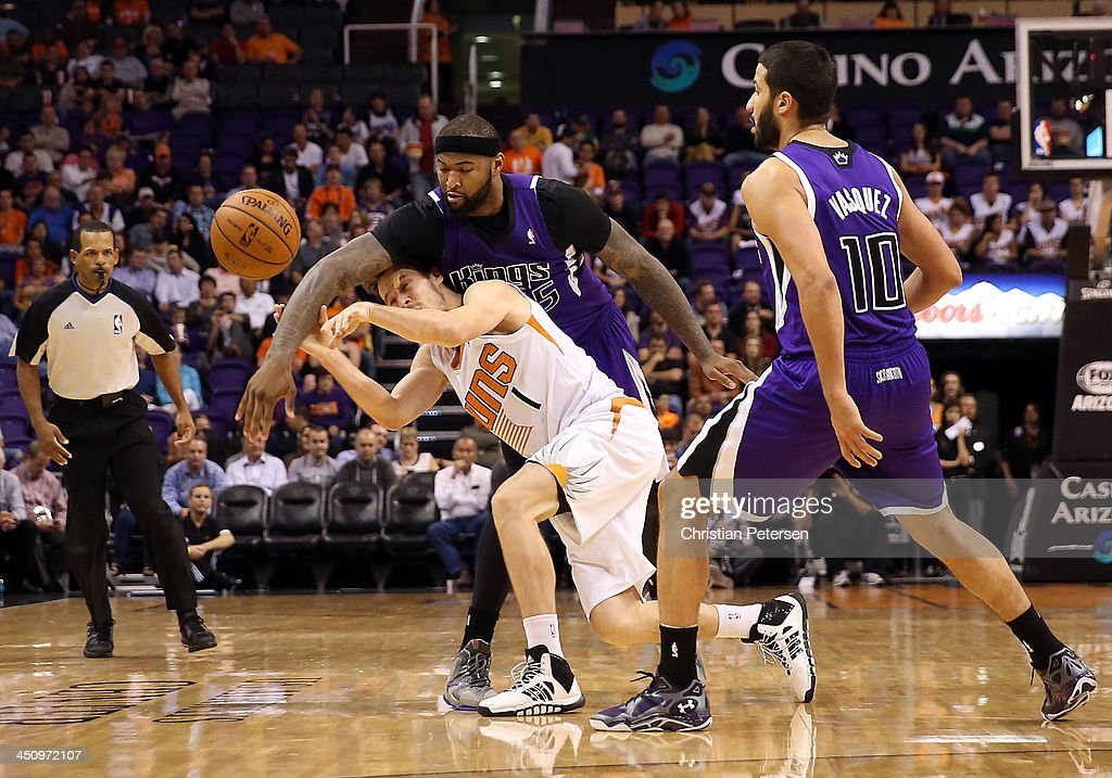 <a gi-track='captionPersonalityLinkClicked' href=/galleries/search?phrase=Goran+Dragic&family=editorial&specificpeople=4452965 ng-click='$event.stopPropagation()'>Goran Dragic</a> #1 of the Phoenix Suns attempts a pass under pressure from <a gi-track='captionPersonalityLinkClicked' href=/galleries/search?phrase=DeMarcus+Cousins&family=editorial&specificpeople=5792008 ng-click='$event.stopPropagation()'>DeMarcus Cousins</a> #15 of the Sacramento Kings during the second half of the NBA game at US Airways Center on November 20, 2013 in Phoenix, Arizona. The Kings defeated the Suns 113-106.