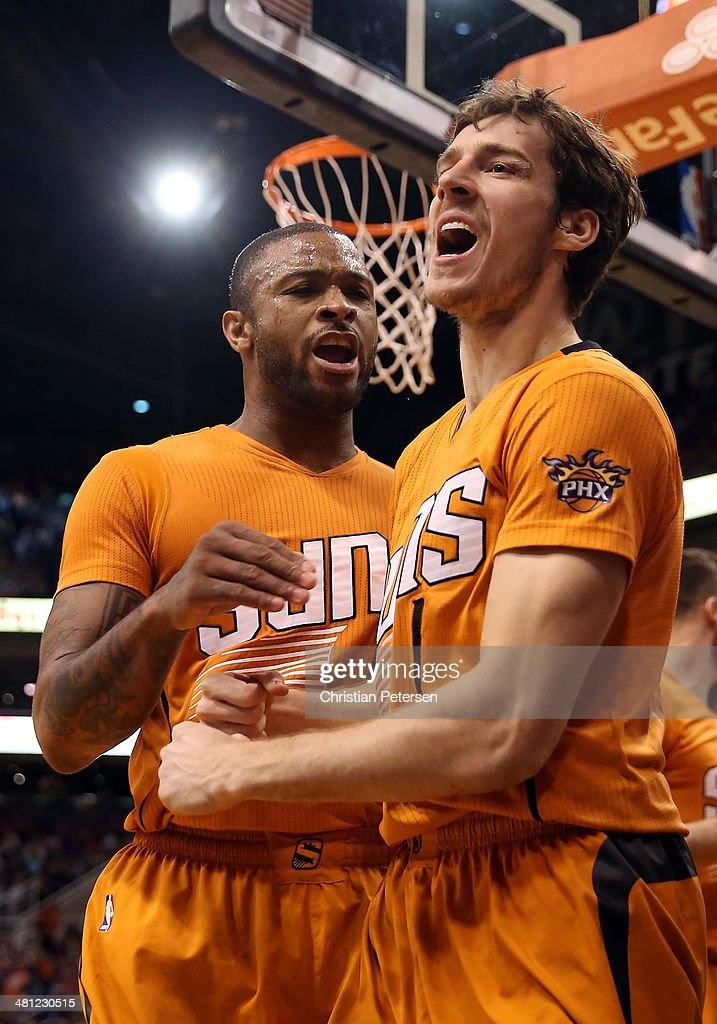 <a gi-track='captionPersonalityLinkClicked' href=/galleries/search?phrase=Goran+Dragic&family=editorial&specificpeople=4452965 ng-click='$event.stopPropagation()'>Goran Dragic</a> #1 of the Phoenix Suns celebrates alongside <a gi-track='captionPersonalityLinkClicked' href=/galleries/search?phrase=P.J.+Tucker&family=editorial&specificpeople=227316 ng-click='$event.stopPropagation()'>P.J. Tucker</a> #17 after scoring against the New York Knicks during the second half of the NBA game at US Airways Center on March 28, 2014 in Phoenix, Arizona. The Suns defeated the Knicks 112-88.