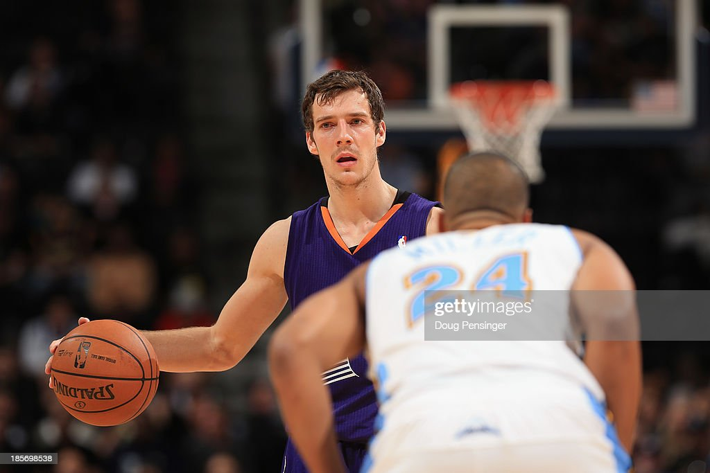 <a gi-track='captionPersonalityLinkClicked' href=/galleries/search?phrase=Goran+Dragic&family=editorial&specificpeople=4452965 ng-click='$event.stopPropagation()'>Goran Dragic</a> #1 of the Phoenix Suns controls the ball against Andre Miller #24 of the Denver Nuggets during preseason action at Pepsi Center on October 23, 2013 in Denver, Colorado. The Suns defeated the Nuggets 98-79.