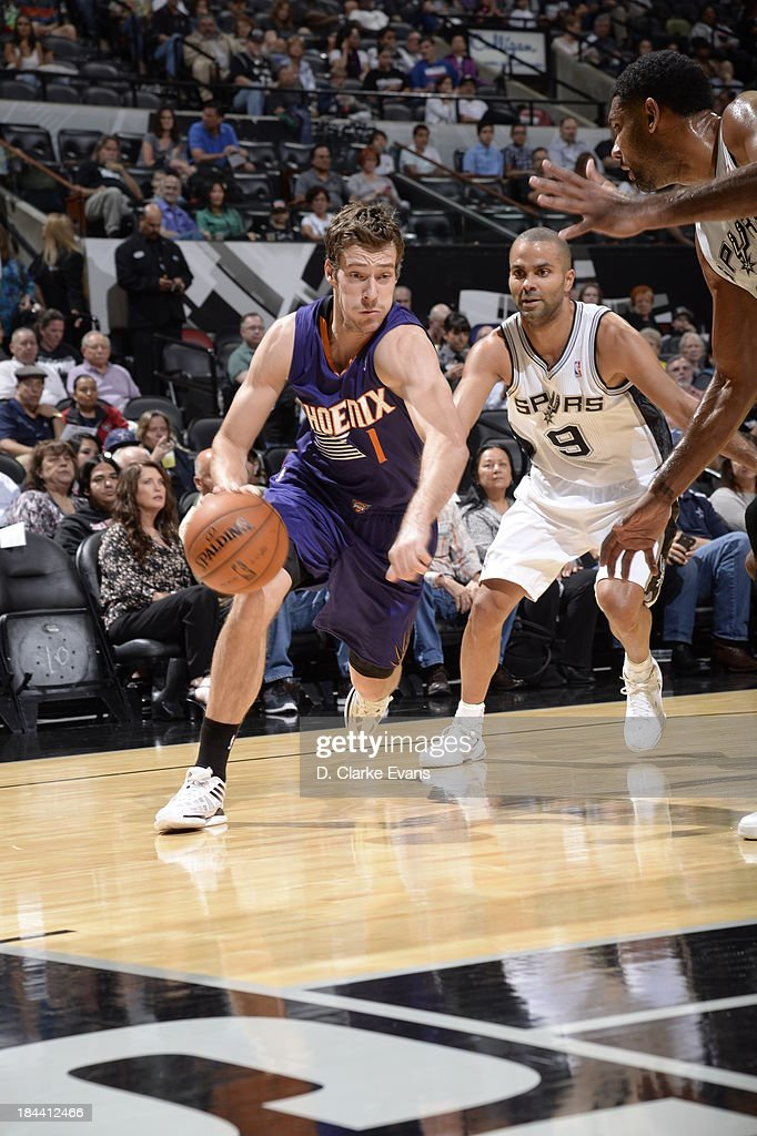 Goran Dragic #1 of the Phoenix Suns dribbles the ball against the San Antonio Spurs during the preseason at the AT&T Center on October 13, 2013 in San Antonio, Texas.