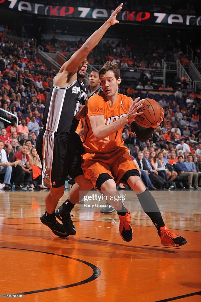 Goran Dragic #1 of the Phoenix Suns drives against Cory Joseph #5 of the San Antonio Spurs on February 21, 2014 at U.S. Airways Center in Phoenix, Arizona.