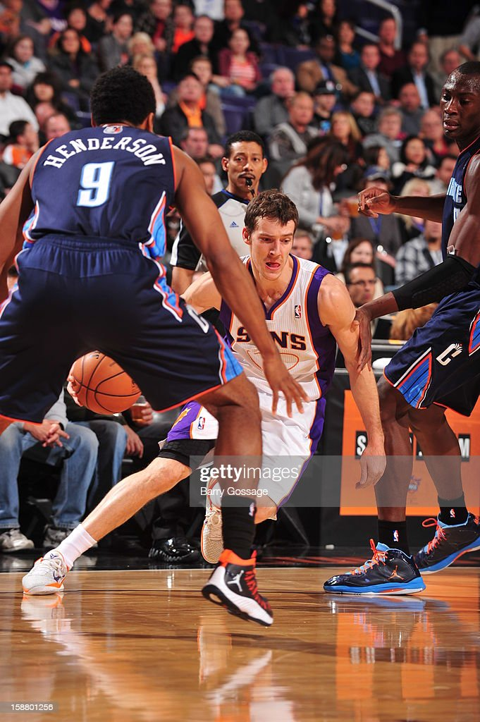 <a gi-track='captionPersonalityLinkClicked' href=/galleries/search?phrase=Goran+Dragic&family=editorial&specificpeople=4452965 ng-click='$event.stopPropagation()'>Goran Dragic</a> #1 of the Phoenix Suns drives against Gerald Henderson #9 of the Charlotte Bobcats on December 19, 2012 at U.S. Airways Center in Phoenix, Arizona.
