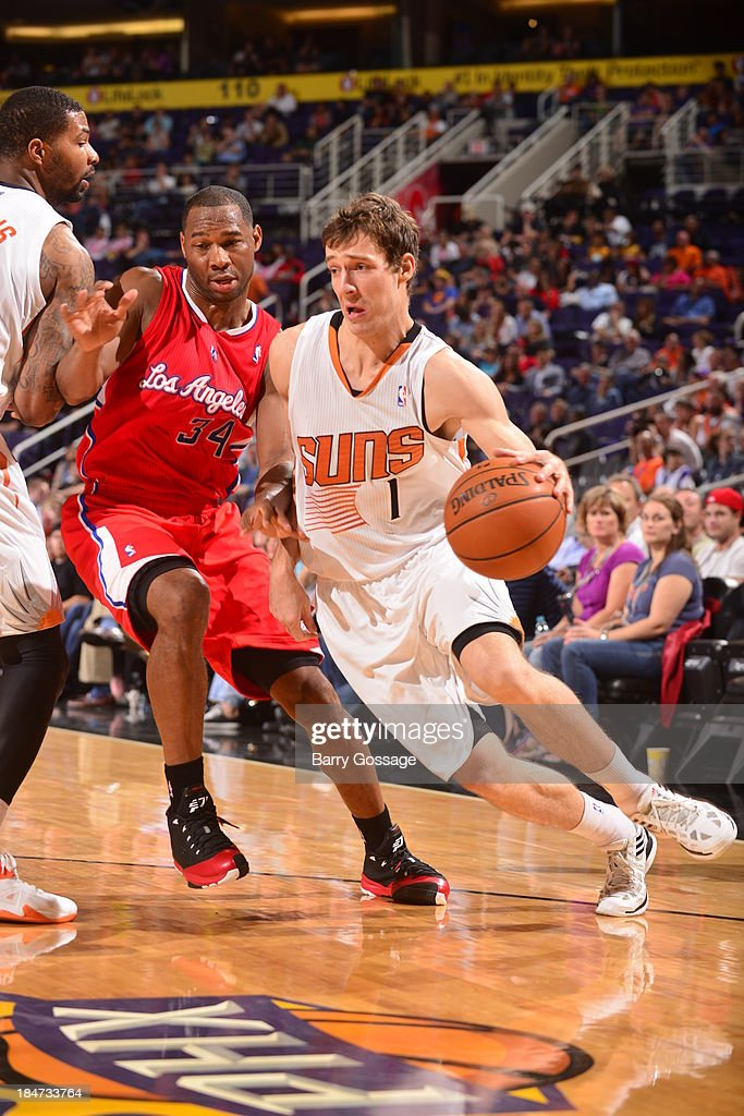 <a gi-track='captionPersonalityLinkClicked' href=/galleries/search?phrase=Goran+Dragic&family=editorial&specificpeople=4452965 ng-click='$event.stopPropagation()'>Goran Dragic</a> #1 of the Phoenix Suns drives against <a gi-track='captionPersonalityLinkClicked' href=/galleries/search?phrase=Willie+Green&family=editorial&specificpeople=201653 ng-click='$event.stopPropagation()'>Willie Green</a> #34 of the Los Angeles Clipper on October 15, 2013 at U.S. Airways Center in Phoenix, Arizona.